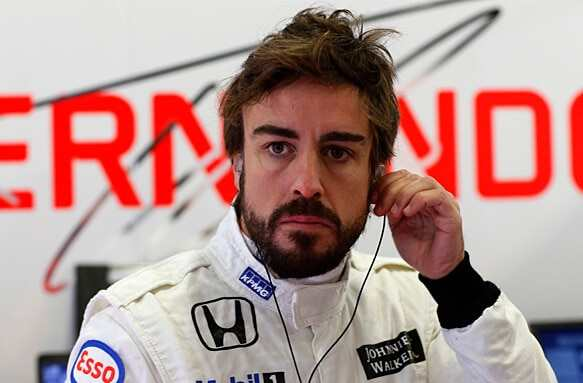 2015 F1 Pre Season Test 1 - Day 1 Circuito de Jerez, Jerez, Spain. Friday 20 February 2015. Fernando Alonso, McLaren, in the garage. World Copyright: Alastair Staley/LAT Photographic. ref: Digital Image _79P3465